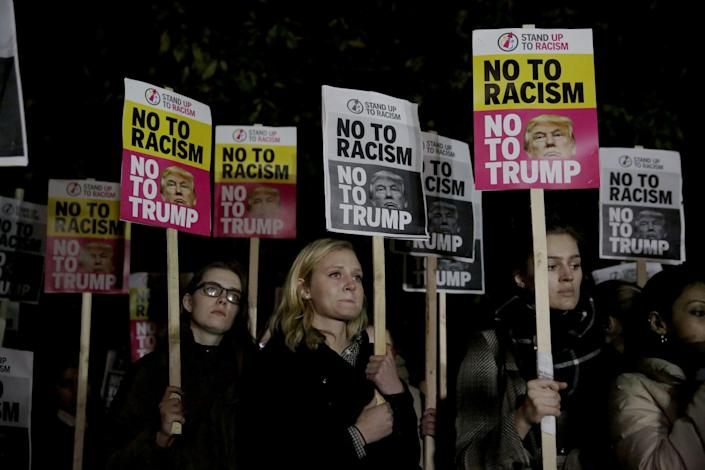 <p>People hold placards as they take part in an anti-racism protest against President-elect Donald Trump winning the American election, outside the U.S. embassy in London, Wednesday, Nov. 9, 2016. Democratic presidential candidate Hillary Clinton conceded her defeat to Republican Donald Trump after the hard-fought presidential election. (AP Photo/Matt Dunham) </p>