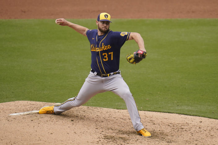 Milwaukee Brewers starting pitcher Adrian Houser works against a San Diego Padres batter during the fourth inning of a baseball game Wednesday, April 21, 2021, in San Diego. (AP Photo/Gregory Bull)