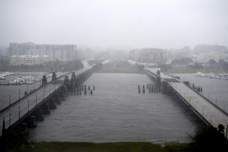 Heavy rain and wind move through Charleston, S.C. on Thursday, Sept. 5, 2019. Hurricane Dorian raked the coastal Carolinas with howling, window-rattling winds and sideways rain Thursday, spinning off tornadoes and knocking out power to more than 200,000 homes and businesses as it pushed northward toward the dangerously exposed Outer Banks. (AP Photo/Meg Kinnard)