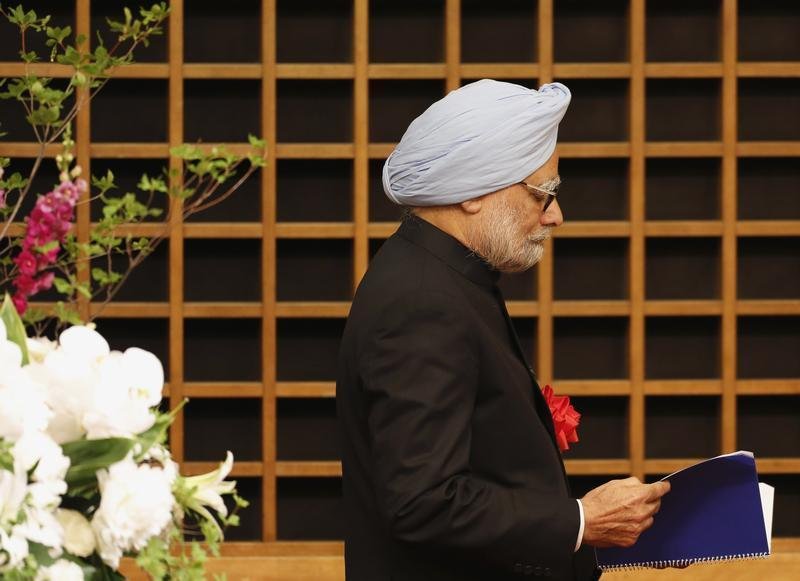 Indian Prime Minister Manmohan Singh walks towards podium to deliver his speech in Tokyo