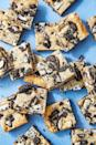 """<p>These blondies have both Oreos <em>and </em>Hershey's Cookies 'N' Creme Bars. 🙌</p><p>Get the recipe from <a href=""""https://www.delish.com/cooking/recipe-ideas/a48360/cookies-and-cream-blondies/"""" rel=""""nofollow noopener"""" target=""""_blank"""" data-ylk=""""slk:Delish"""" class=""""link rapid-noclick-resp"""">Delish</a>.</p>"""