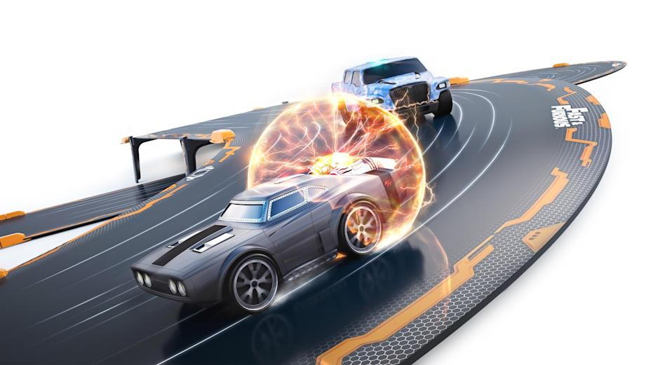 """<p>Channel your inner Vin Diesel with this next-gen racing system combining smartphone-controlled robotic cars and a video game based on the 'Fast & Furious' ecosystem. Build your track, download the app, and stage an epic street-race battle in your living room. <a href=""""https://theringer.com/fast-furious-movies-corona-beer-character-development-product-placement-f6bbdfc765a0"""" rel=""""nofollow noopener"""" target=""""_blank"""" data-ylk=""""slk:Coronas not included"""" class=""""link rapid-noclick-resp"""">Coronas not included</a>.<br><strong>Buy: <a href=""""https://www.toysrus.com/product?productId=133301656"""" rel=""""nofollow noopener"""" target=""""_blank"""" data-ylk=""""slk:Toys """"R"""" Us"""" class=""""link rapid-noclick-resp"""">Toys """"R"""" Us</a></strong> </p>"""