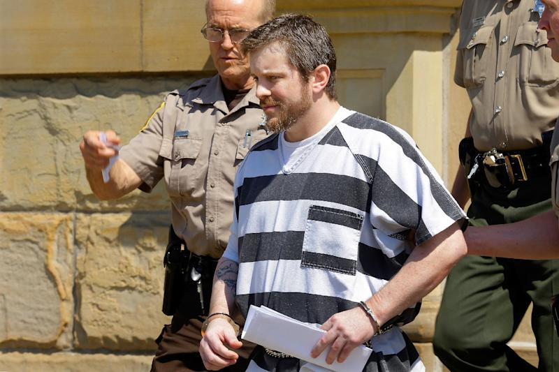 Christopher Harris, a central Illinois man who was convicted of killing five members of a Beason, Ill., family leaves court after being sentenced to five consecutive life sentences at the Logan Country Courthouse Friday, July 19, 2013, in Lincoln Ill. (AP Photo/Seth Perlman)