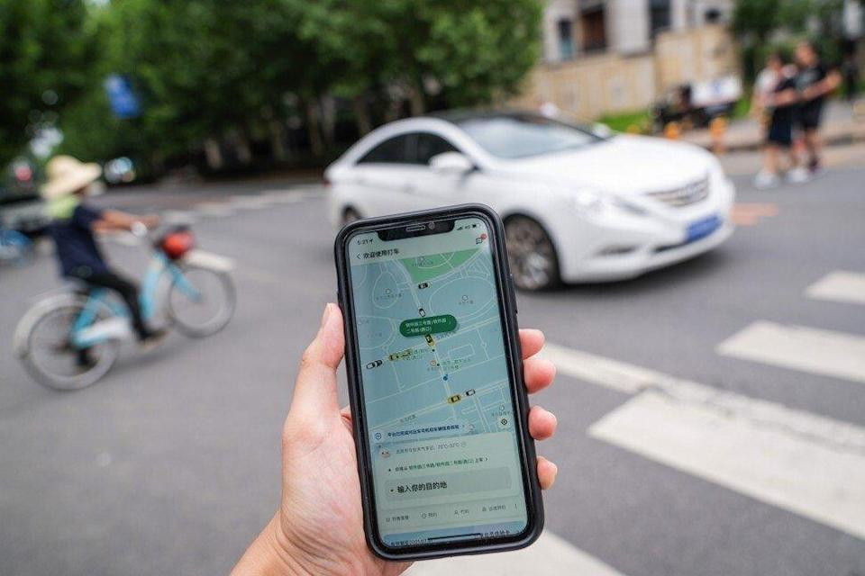 Didi's ride-hailing app on a smartphone arranged in Beijing on Monday, July 5, 2021. Photo: Bloomberg