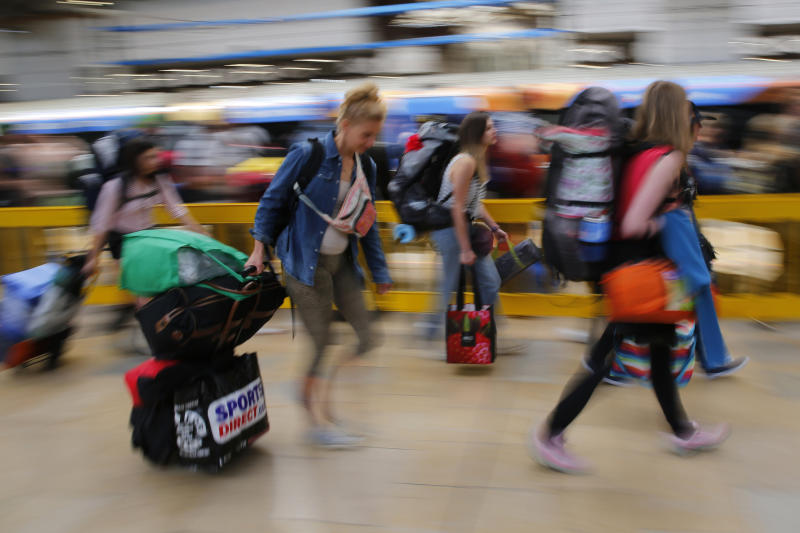 Revellers queue to board a train for the Glastonbury Festival, at Paddington Station in London, Britain June 24, 2015. REUTERS/Stefan Wermuth