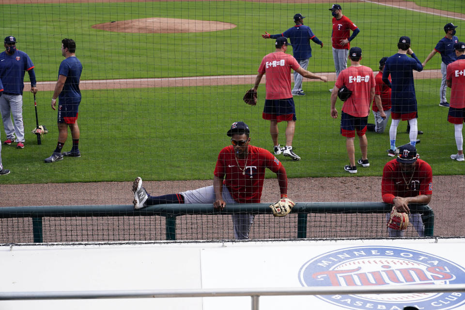 Minnesota Twins shortstop Jorge Polanco (11) stretches near the dugout during spring training baseball practice on Wednesday, Feb. 24, 2021, in Fort Myers, Fla. (AP Photo/Brynn Anderson)