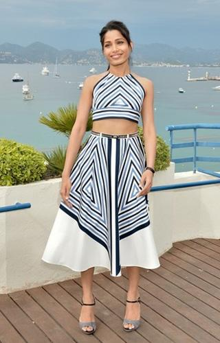 "<b>Who:</b> Freida Pinto <br><b>What:</b> Salvatore Ferragamo halter top and skirt <b>Where:</b> Desert Dancer photocall <br><b>Why We Love It:</b>  Freida Pinto had a banner festival, sporting a handful of beautiful  looks during the first few days of Cannes and stepping up as a real red  carpet player. The Indian actress wore a trio of sexy dresses with  thigh-high slits to the evening premieres, including a stunning Michael  Angel gown with a colourful crystal bodice at Moonrise Kingdom, but for  shear chic we absolutely love this striped Ferragamo ensemble. Pinto  looks laid back, fresh and incredibly pretty. Photo by George Pimentel<br> <br> <b>More on Flare:</b><br> <br> <a target=""_blank"" href=""http://www.flare.com/blog/post/62911--looks-we-love-jessica-chastain-s-fiery-red-hair-at-cannes-2012"">Looks we love: Jessica Chastain's fiery red hair at Cannes</a><br>"