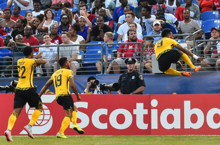 Jamaica's Giles Barnes (R) celebrates scoring against Haiti during a CONCACAF Gold Cup quarterfinal football match in Baltimore on July 18, 2015