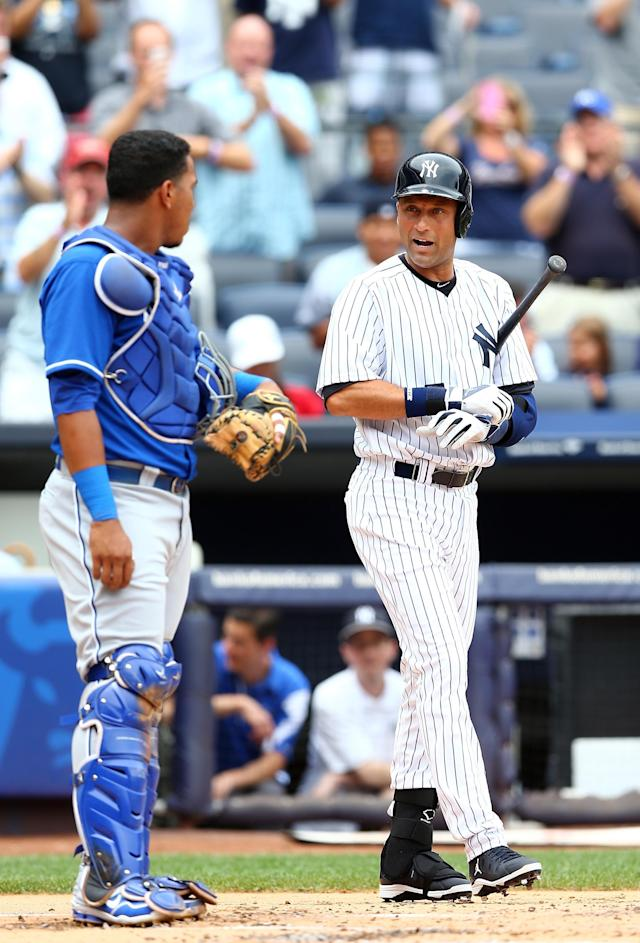 NEW YORK, NY - JULY 11: Derek Jeter #2 of the New York Yankees talks with Salvador Perez #13 of the Kansas City Royals as he takes his turn at bat in the first inning on July11,2013 at Yankee Stadium in the Bronx borough of New York City. (Photo by Elsa/Getty Images)