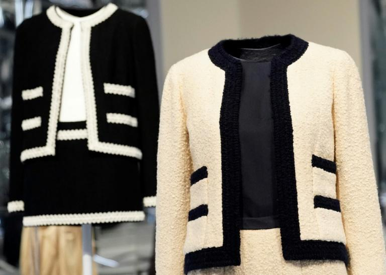 The original Chanel skirtsuit on the right, with a contemporary version with a mini-skirt from Karl Lagerfeld