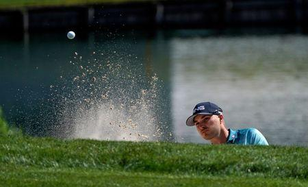 Mar 22, 2019; Palm Harbor, FL, USA; Austin Cooke plays his shot from the bunker on the 12th hole during the second round of the Valspar Championship golf tournament at Innisbrook Resort - Copperhead Course. Mandatory Credit: Jasen Vinlove-USA TODAY Sports