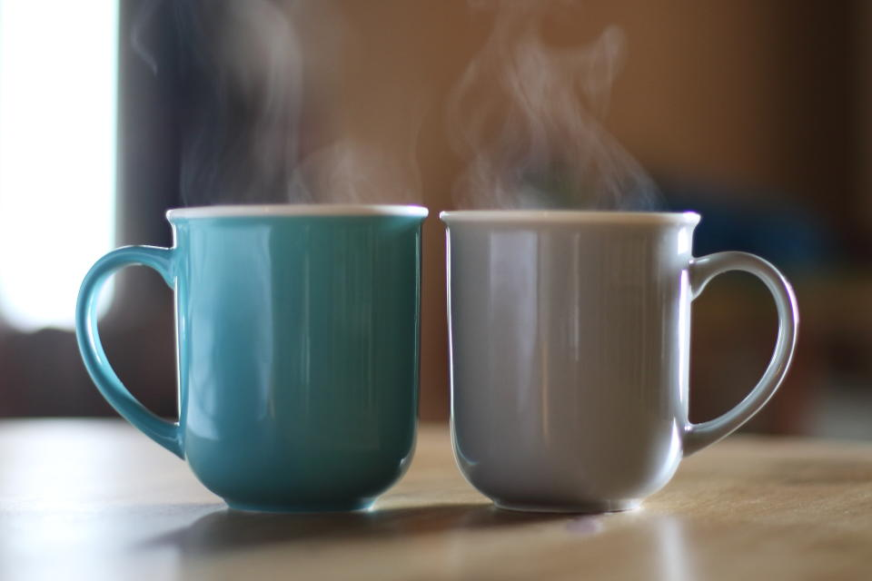 two steaming coffee cups