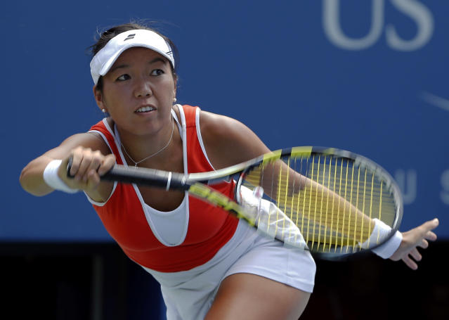 Vania King, of the United States, returns a shot to Serena Williams, of the United States, during the second round of the 2014 U.S. Open tennis tournament, Thursday, Aug. 28, 2014, in New York. (AP Photo/Elise Amendola)