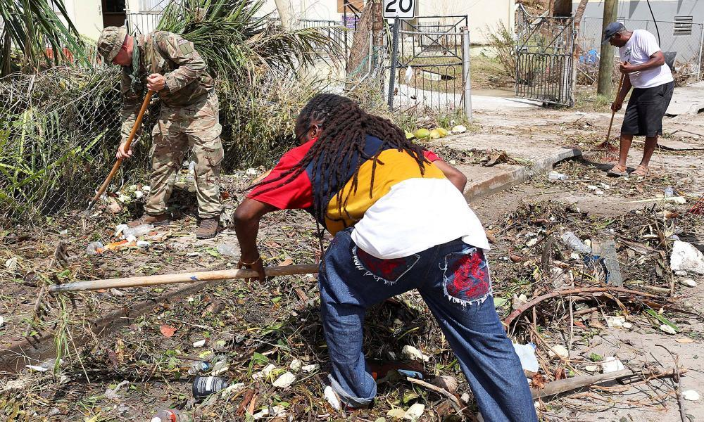 """<span class=""""element-image__caption"""">British army commandos and local residents take part in recovery efforts after Hurricane Irma passed Tortola, in the British Virgin Islands.</span> <span class=""""element-image__credit"""">Photograph: Handout/Reuters</span>"""