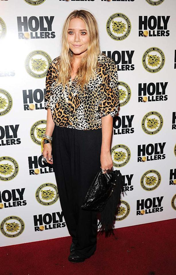 "Thanks to her matronly, cheetah-print blouse, Mary-Kate Olsen looks more like a cast member of ""The Real Housewives of New Jersey"" than a 23-year-old trendsetter. Bryan Bedder/<a href=""http://www.gettyimages.com/"" target=""new"">GettyImages.com</a> - May 10, 2010"