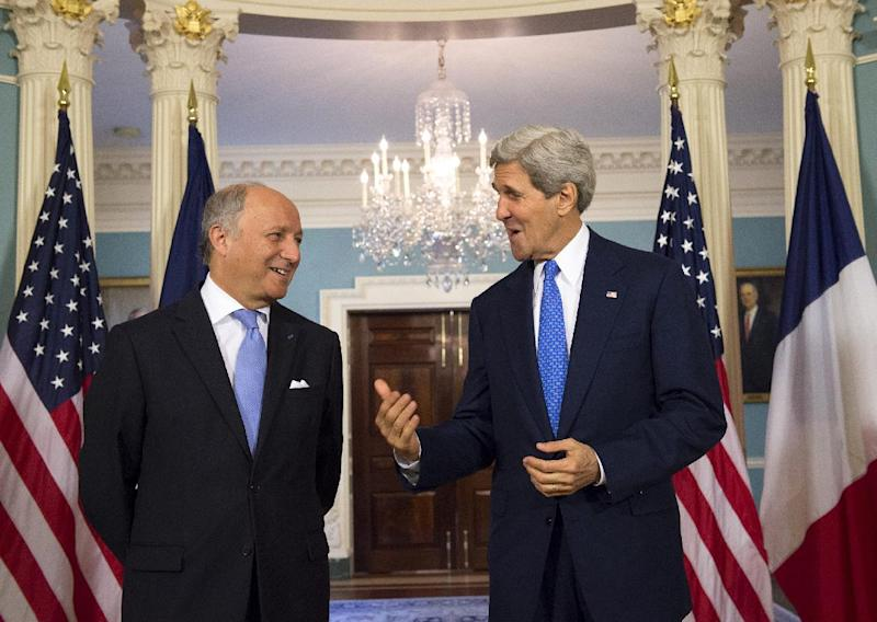 Secretary of State John Kerry and French Foreign Minister Laurent Fabius speak prior to their meeting at the State Department in Washington, Tuesday, May 13, 2014. (AP Photo/Molly Riley)