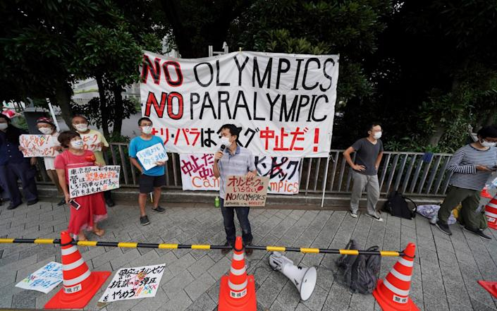Protesters demonstrate against the Olympic and Paralympic Games, in front of the Prime Minister's Office, in Tokyo, Japan on 2 August 2021 - Kantaro Komiya/AP