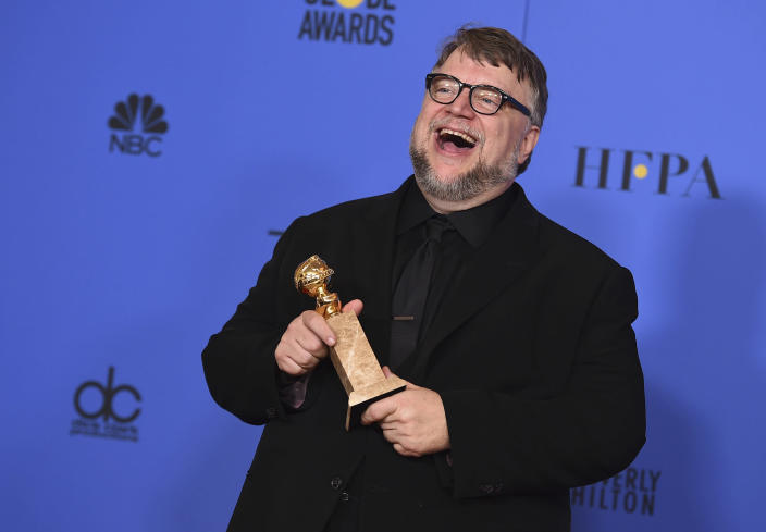 """FILE - Guillermo del Toro poses in the press room with the award for best director for a motion picture for """"The Shape of Water"""" at the 75th annual Golden Globe Awards on Jan. 7, 2018, in Beverly Hills, Calif. Del Toro turns 56 on Oct. 9. (Photo by Jordan Strauss/Invision/AP, File)"""