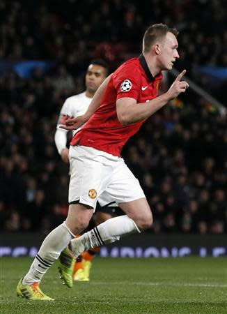 Manchester United's Phil Jones celebrates scoring during their Champions League soccer match against Shakhtar Donetsk at Old Trafford in Manchester, northern England December 10, 2013. REUTERS/Phil Noble