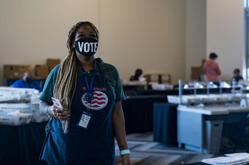 An election worker processes absentee ballots at State Farm Arena on November 2, 2020 in Atlanta, Ga.