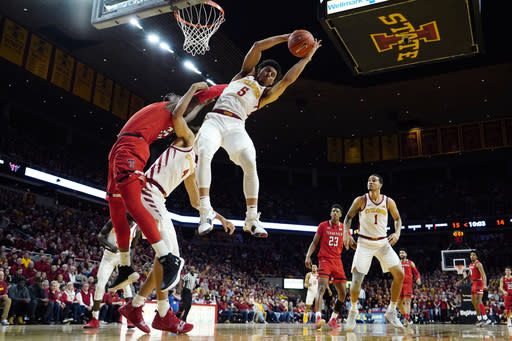 Iowa State guard Lindell Wigginton (5) grabs a rebound over Texas Tech center Norense Odiase, left, during the first half of an NCAA college basketball game, Saturday, March 9, 2019, in Ames, Iowa. (AP Photo/Charlie Neibergall)