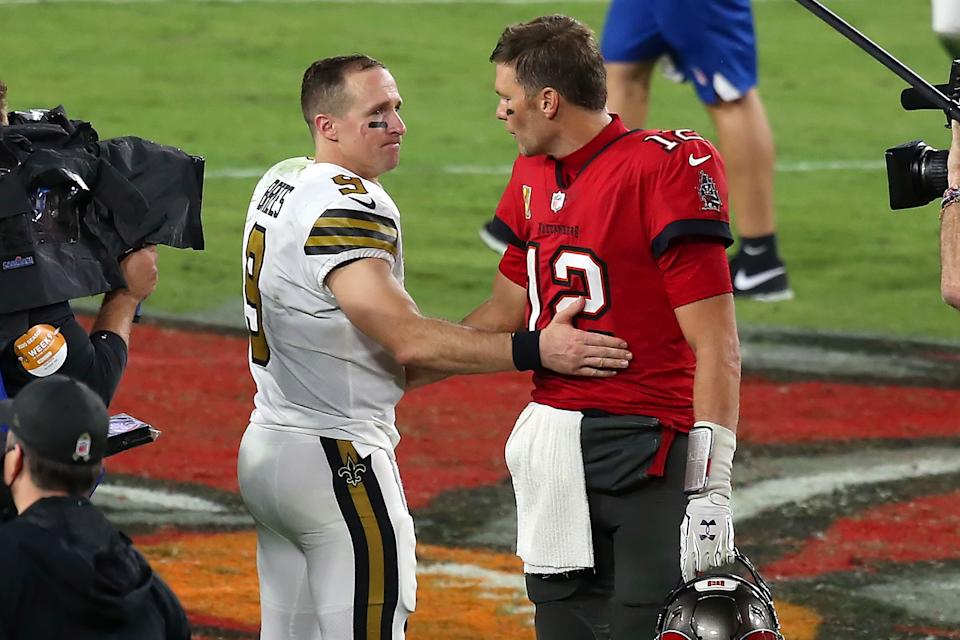 TAMPA, FL - NOVEMBER 08: Two of the greatest quarterbacks in NFL history Drew Brees (9) of the Saints and Tom Brady (12) of the Buccaneers share a few words of encouragement after the regular season game between the New Orleans Saints and the Tampa Bay Buccaneers on November 08, 2020 at Raymond James Stadium in Tampa, Florida. (Photo by Cliff Welch/Icon Sportswire via Getty Images)