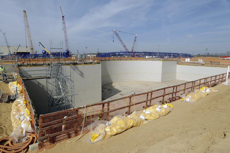 FILE- In this Feb. 15, 2012 file pool photo, the Unit 3 nuclear island where a new nuclear reactor will sit is seen before a visit by U.S. Secretary of Energy Secretary Steven Chu at the Vogtle nuclear power plant in Waynesboro, Ga. Vogtle initially estimated to cost $14 billion, has run into over $800 million in extra charges related to licensing delays. A state monitor has said bluntly that co-owner, Southern Co. can't stick to its budget. The plant, whose first reactor was supposed to be operational by April 2016, is now delayed seven months.(AP Photo/David Goldman, Pool, File)