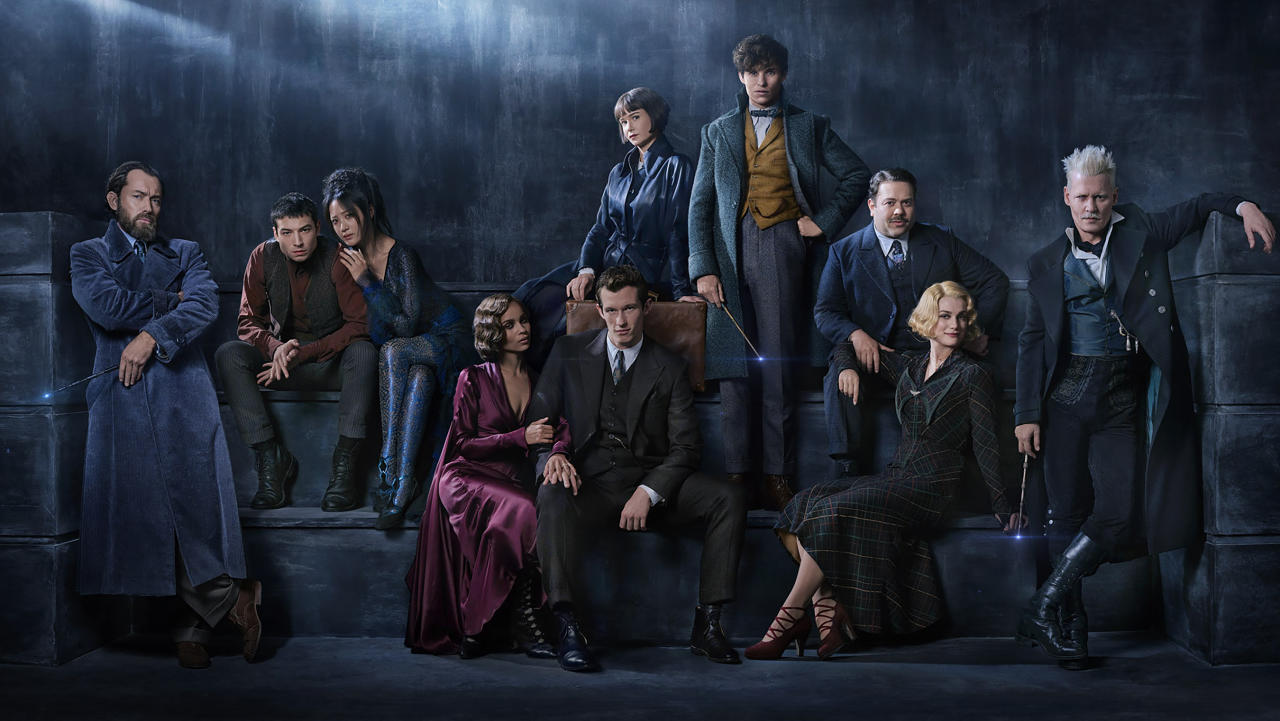 <p>The full ensemble (from left): Jude Law joins the cast as the young Albus Dumbledore; Ezra Miller returns as Credence; Claudia Kim plays Maledictus, carrier of a blood curse that destines her ultimately to transform into a beast; Zoë Kravitz plays Leta Lestrange, Newt's former paramour, now engaged to his brother; Callum Turner plays Newt's older brother, Theseus Scamander, a celebrated war hero and the head of the Auror Office at the British Ministry of Magic; Katherine Waterston returns as Tina Goldstein; Eddie Redmayne stars as magizoologist Newt Scamander, who has published his research in <em>Fantastic Beasts and Where to Find Them</em>; Dan Fogler reprises the role of the only No-Maj in the group, Jacob Kowalski; Alison Sudol is back as Tina's free-spirited sister, Queenie Goldstein, a Legilimens who can read minds; and Johnny Depp returns as the powerful dark wizard Gellert Grindelwald.<br /> (Photo: Warner Bros.) </p>
