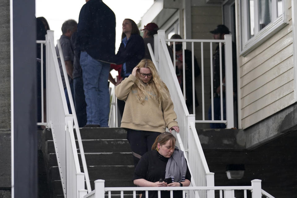 People leave a briefing for family members by Coast Guard and NTSB officials in Port Fouchon, La., Friday, April 16, 2021, after a lift boat capsized in the Gulf of Mexico during a storm on Tuesday. (AP Photo/Gerald Herbert)