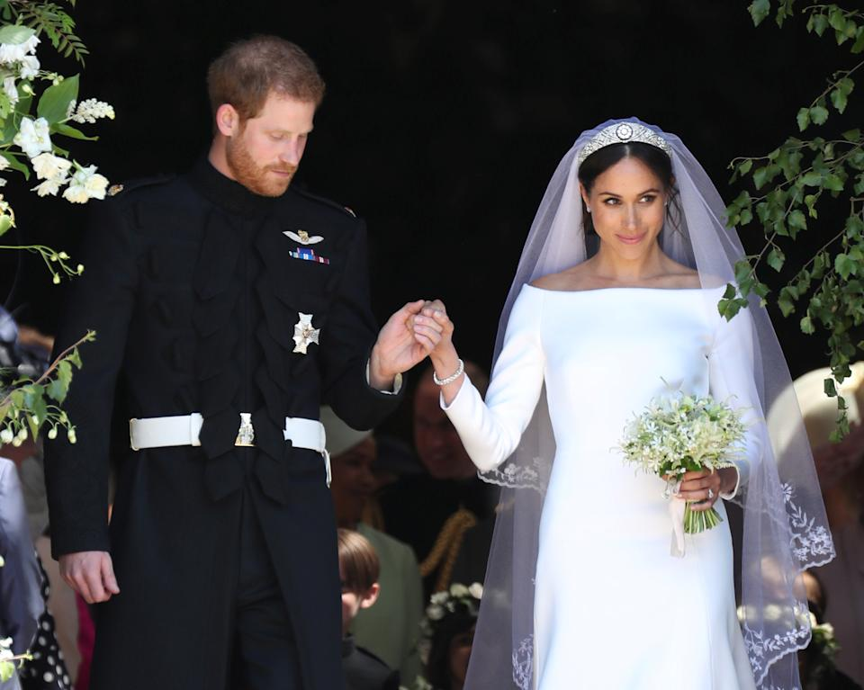 Meghan Markle and Prince Harry leave St George's Chapel at Windsor Castle following their wedding. PRESS ASSOCIATION Photo. Picture date: Saturday May 19, 2018. See PA story ROYAL Wedding. Photo credit should read: Jane Barlow/PA Wire/Pool via REUTERS