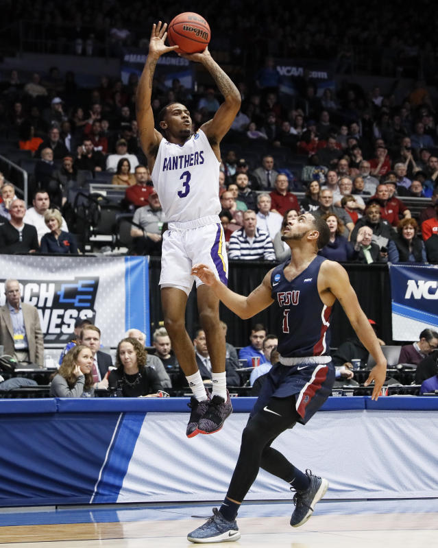 Prairie View A&M's Gary Blackston (3) shoots over Fairleigh Dickinson's Darnell Edge (1) during the second half of a First Four game of the NCAA college basketball tournament, Tuesday, March 19, 2019, in Dayton, Ohio. (AP Photo/John Minchillo)