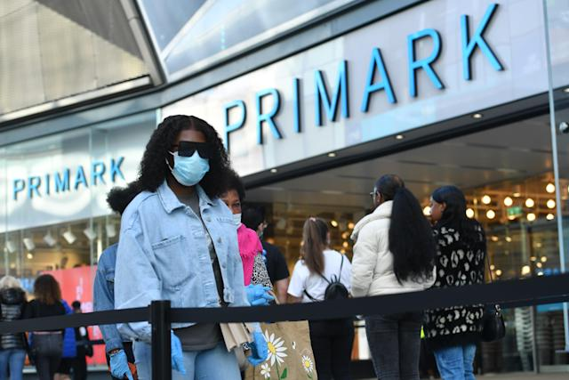 Shoppers in line at Primark in Birmingham as non-essential shops in England open their doors to customers for the first time since coronavirus lockdown restrictions were imposed in March. (Jacob King/PA Images via Getty Images)