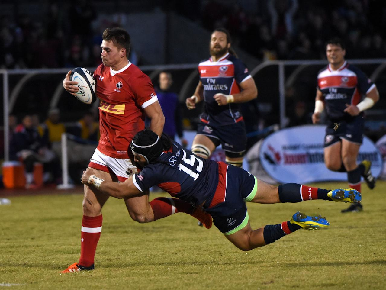 Mike Te'o (R) of the USA makes a tackle against Canada (L) during their Americas Rugby Championship match at Swangard Stadium in Burnaby, BC, Canada February 18, 2017.USA won 51-34. (AFP Photo/Don MacKinnon)