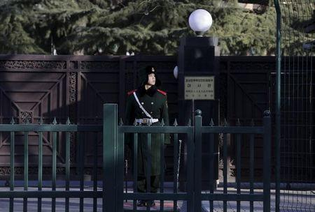 A paramilitary policeman stands guard in front of the North Korean embassy in Beijing, China, February 7, 2016. REUTERS/Jason Lee