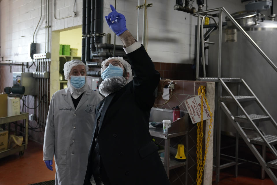 Rabbis Joseph Schwartz, left, and Mendel Einhorn confer as they supervise Hanan Products preparations for their kosher-for-passover production run, Thursday, Jan. 7, 2021, in Hicksville, N.Y. The rabbis are tasked with ensuring that the production line and foods made here meet the strict kosher requirements of Passover. (AP Photo/Seth Wenig)