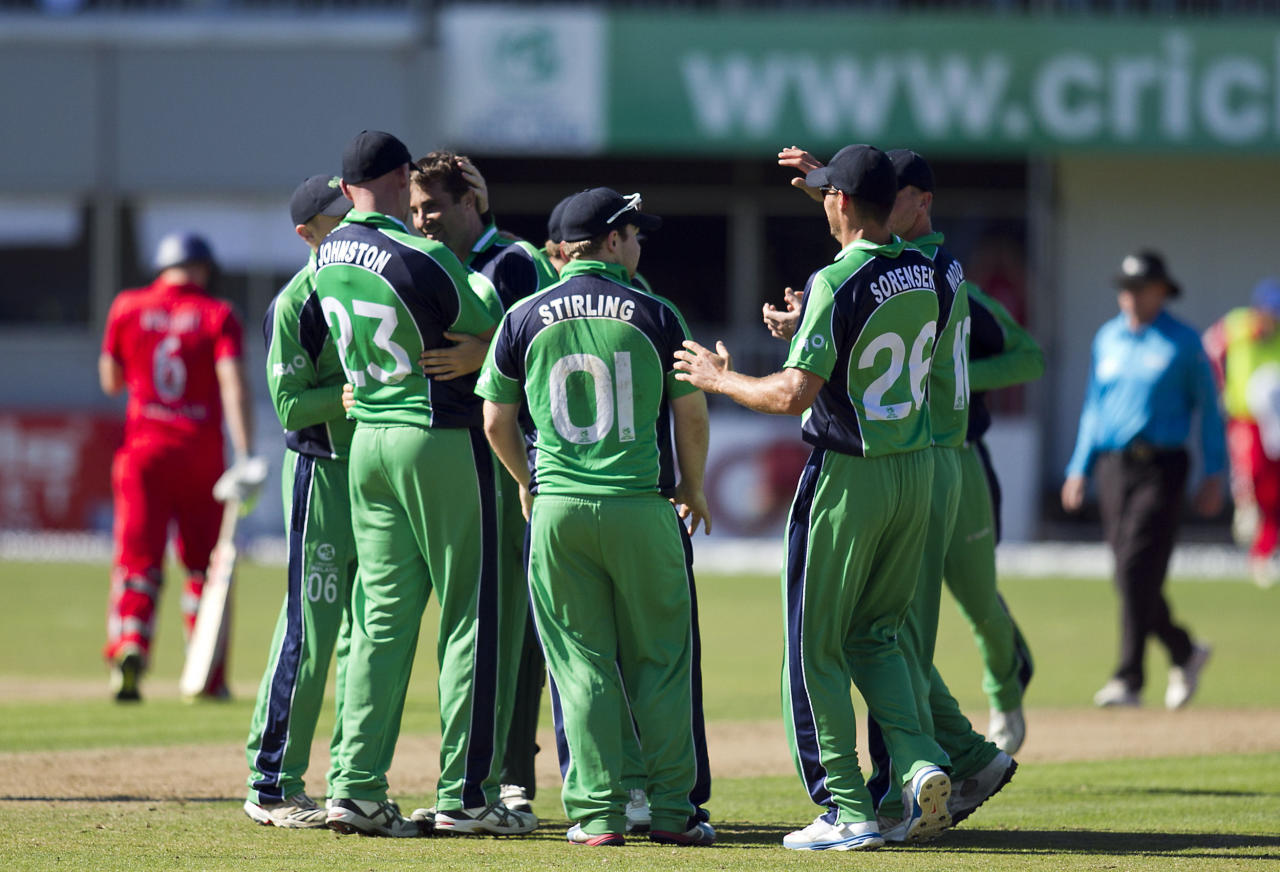 Ireland's Tim Murtagh celebrates with team-mates after bowling England's Luke Wright during the One Day International at The Village, Dublin.