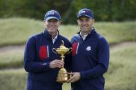 Team USA captain Steve Stricker and Team USA's Jordan Spieth pose for a picture during a practice day at the Ryder Cup at the Whistling Straits Golf Course Wednesday, Sept. 22, 2021, in Sheboygan, Wis. (AP Photo/Charlie Neibergall)