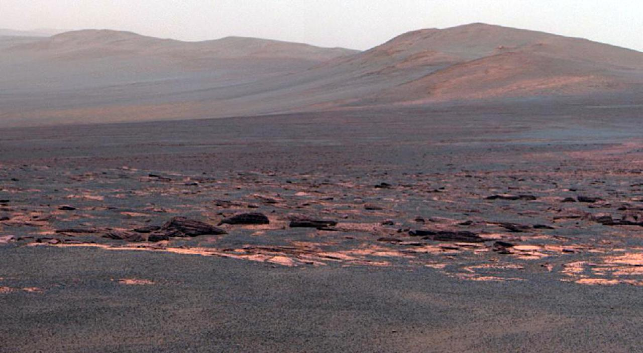 This Aug. 9, 2011 image provided by NASA shows a view from the Mars Rover Opportunity from the Western rim of the Endeavour Crater. This crater -- with a diameter of about 14 miles -- is more than 25 times wider than any that Opportunity has previously approached during the rover's 90 months on Mars. (AP Photo/NASA)