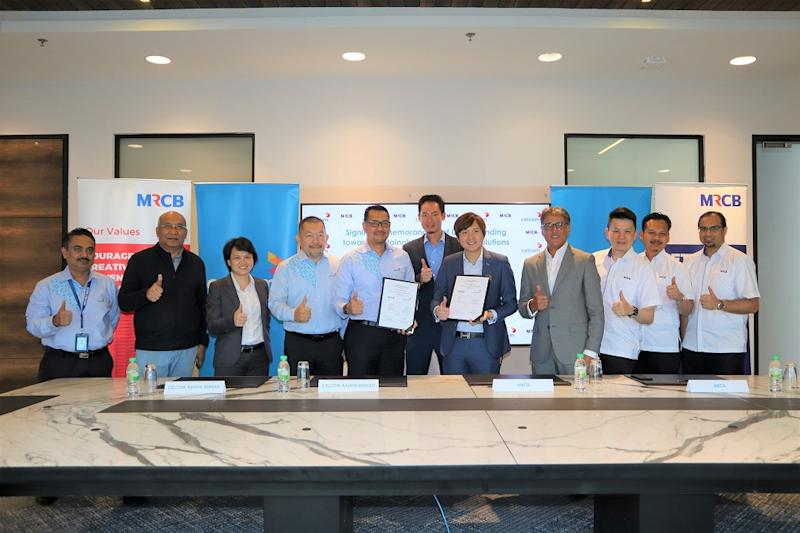 Representatives from the Malaysian Resources Corporation Berhad (MRCB) and Celcom Axiata Berhad at the signing of a memorandum of understanding between the two organisations. — Picture courtesy of MRCB