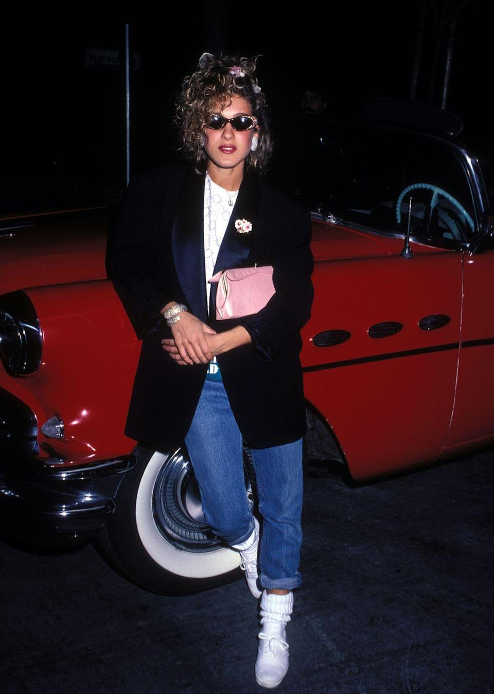 <p>Sarah Jessica Parker wears her scrunched-down sports socks and white sneakers with mom jeans because she's just that cool. </p>