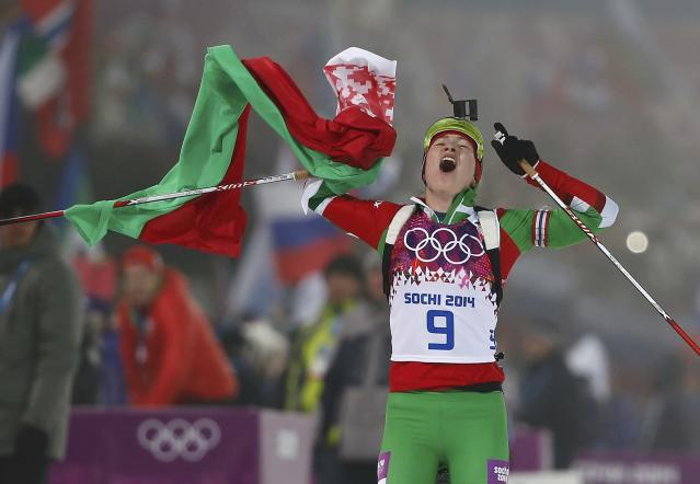 Darya Domracheva of Belarus celebrates after crossing the finish line during the women's biathlon 10km pursuit event at the Sochi 2014 Winter Olympic Games in Rosa Khutor February 11, 2014. REUTERS/Stefan Wermuth (RUSSIA - Tags: OLYMPICS SPORT SKIING)