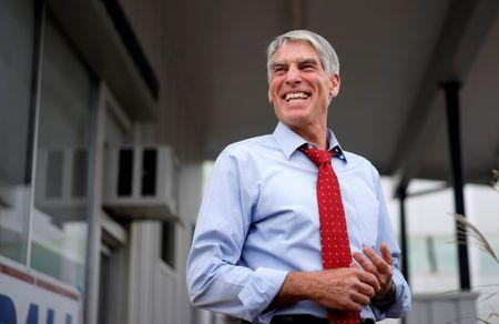 U.S. Senator Mark Udall (D-CO) campaigns at a pre-debate rally in Denver in this October 15, 2014 file photo.    REUTERS/Rick Wilking/Files