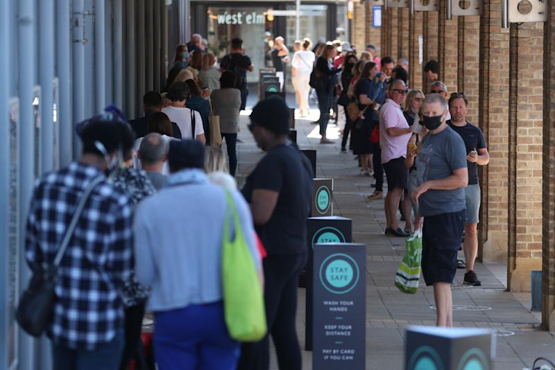 Shoppers in line outside John Lewis in Kingston as non-essential shops in England open their doors to customers for the first time since coronavirus lockdown restrictions were imposed in March. (Photo by Steve Parsons/PA Images via Getty Images)