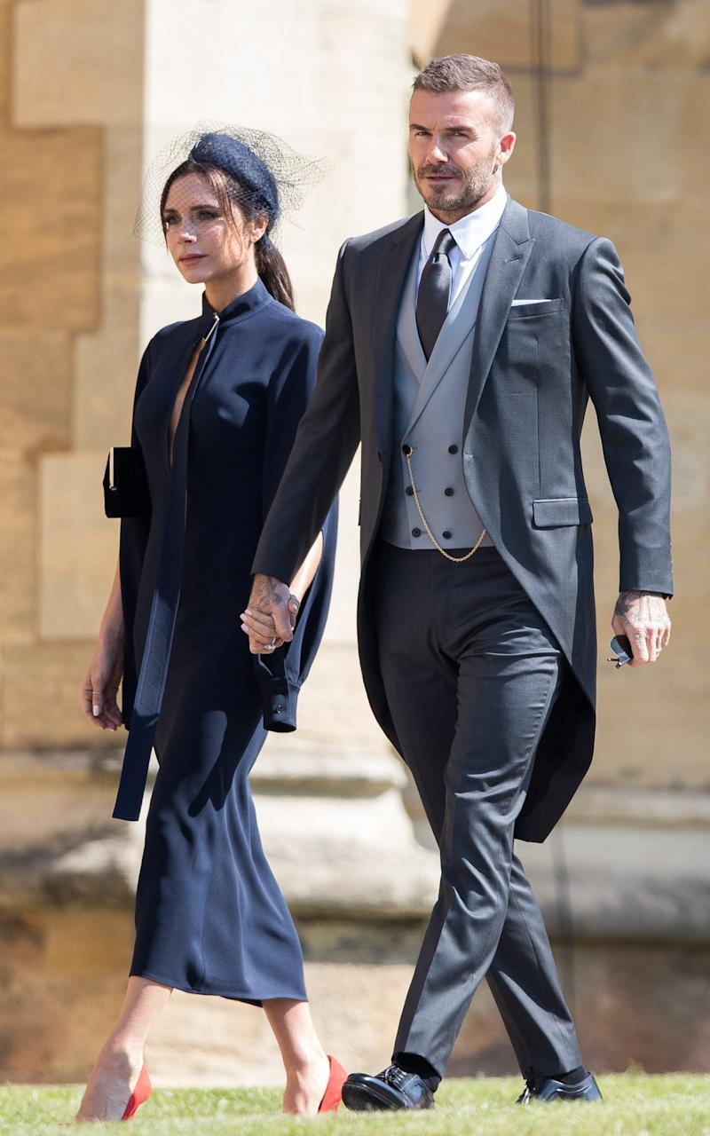 David and Victoria at Meghan and Harry's 2018 wedding - Getty