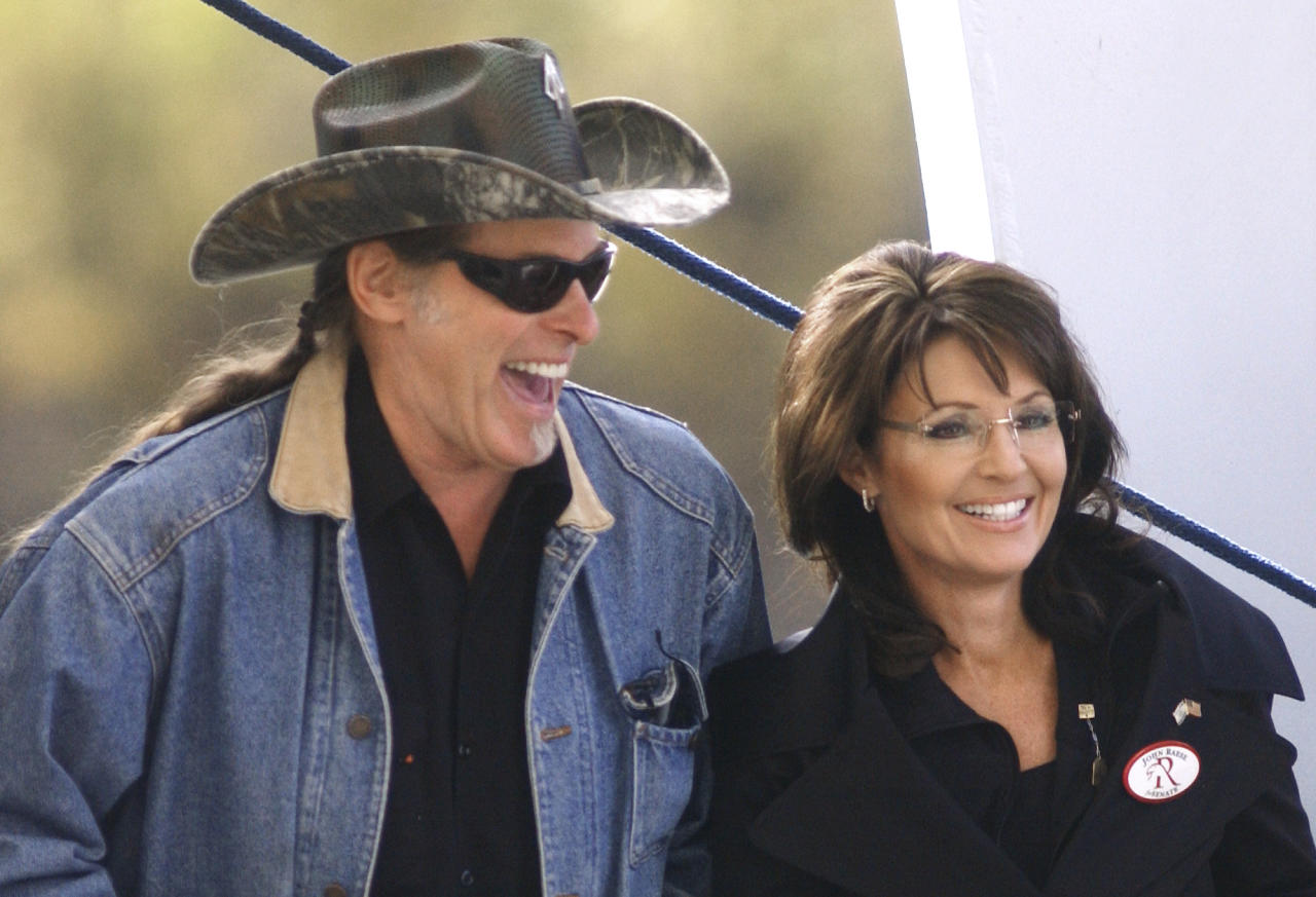 Rocker Ted Nugent and Sarah Palin laugh before a rally for Republican senate candidate John Raese at Haddad Riverfront Park in Charleston, W.Va., on Saturday, Oct. 30, 2010.