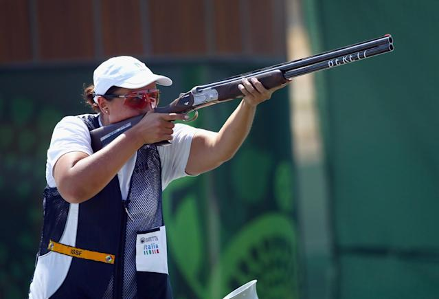 <p>Diana Bacosi of Italy competes during the Women's Skeet shooting final during day eight of the Baku 2015 European Games at the Baku Shooting Centre on June 20, 2015 in Baku, Azerbaijan. (Getty) </p>
