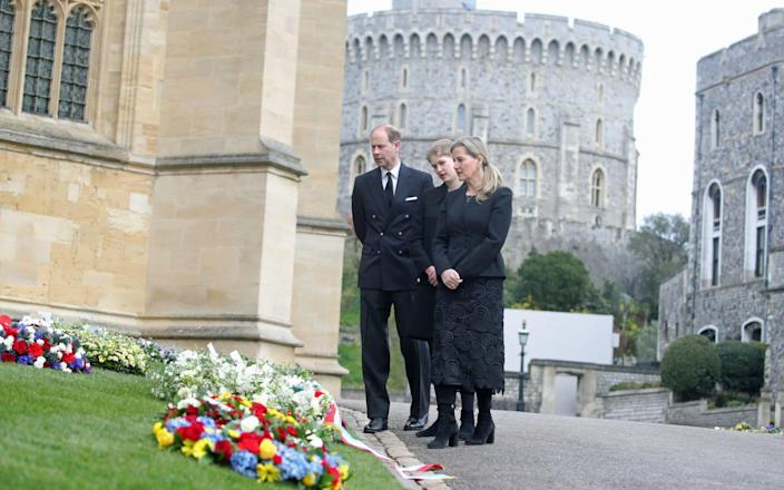 The Earl of Wessex, Lady Louise Windsor and the Countess of Wessex view flowers outside St George's Chapel, at Windsor Castle, Berkshire - Steve Parsons