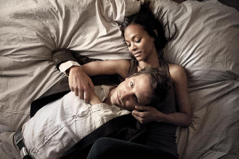"""This film image released by CBS Films shows Bradley Cooper and Zoë Saldana in a scene from """"The Words."""" (AP Photo/CBS Films, Jonathan Wenk)"""
