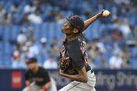 Cleveland Indians starting pitcher Triston McKenzie throws to a Toronto Blue Jays batter during the first inning of a baseball game Thursday, Aug. 5, 2021, in Toronto. (Jon Blacker/The Canadian Press via AP)