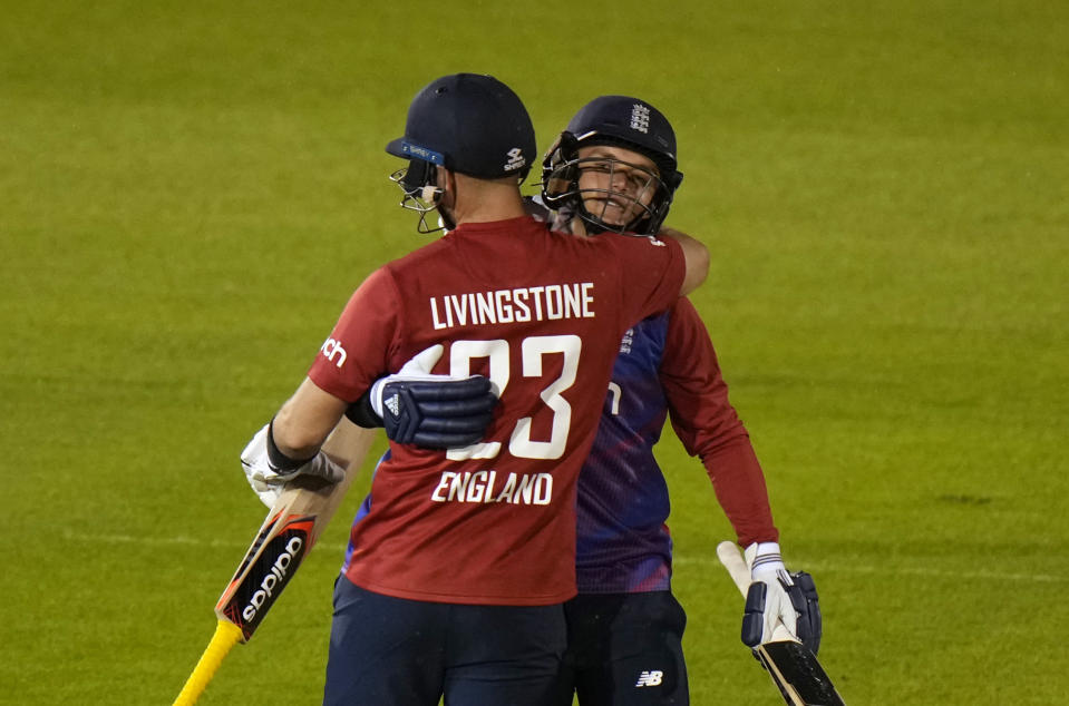 England's Sam Curran, right, hugs teammate England's Liam Livingstone, after defeating Sir Lanka in the second T20 international cricket match between England and Sri Lanka in Cardiff, Wales, Thursday, June 24, 2021. (AP Photo/Alastair Grant)